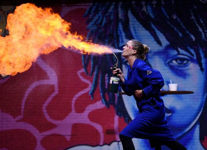 Kate Biberdorf breathes fire during her TEDxDetroit presentation on her love of science.