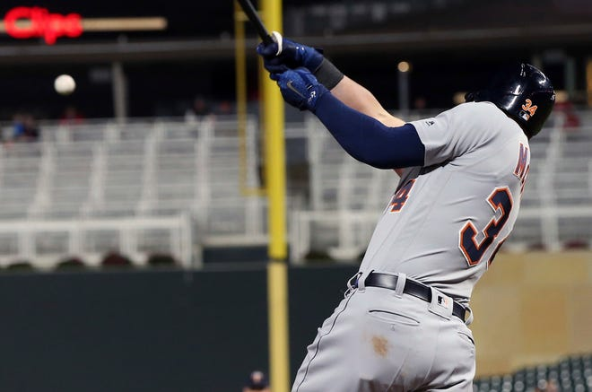 Detroit Tigers' James McCann hits a two-run double off Minnesota Twins pitcher Trevor May in the eighth inning of Tuesday's game.