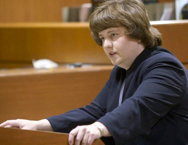 In this Oct. 27, 2004 photo Rachel Mitchell makes an opening statement in the trial of Karl LeClaire at court in Mesa, Ariz. Senate Republicans are bringing Mitchell to handle questioning about allegations of sexual assault against Supreme Court nominee Brett Kavanaugh at Thursday, Sept. 27, 2018 Senate Judiciary Committee hearing.