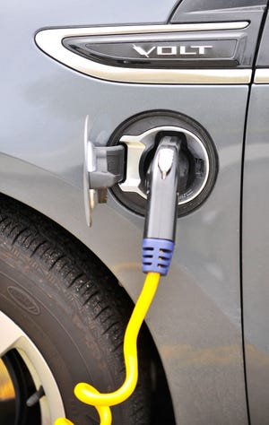 A client's Chevrolet Volt charges at the Pep Station charging station for electric vehicles has been installed outside the office building of Pep Stations, LLC., in Livonia, Mich. on May 10, 2011. The company is the state's only developer of electric vehicles charging stations.