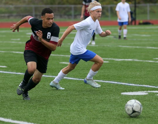 Elmira's Kytrell Stroman, left, and Owen Foster of Horseheads chase after the ball during a 0-0 tie Sept. 25, 2018 at Ernie Davis Academy.