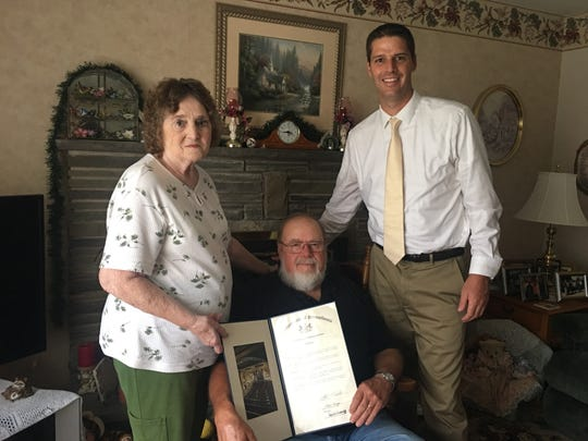 Pennsylvania state Rep. Clint Owlett, right, recognizes Shirley and Royce Weber, of Wellsboro, for 60 years of marriage.