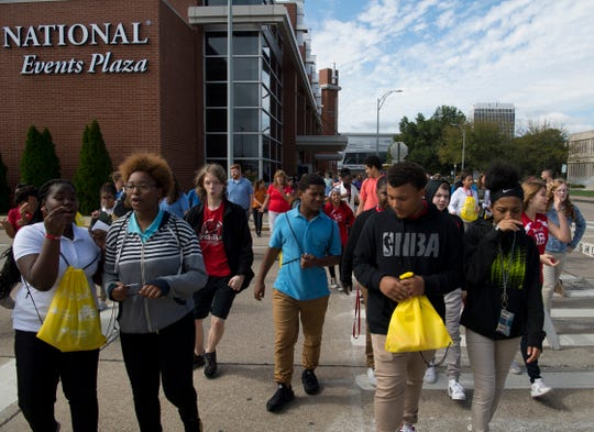 Students head back to their school buses after attending JA JobSpark, a career expo for Tri-State area students in 8th-12th grades, at the Old National Events Plaza in Evansville Wednesday morning. More than 3,500 kids are expected to take part in the two-day event.