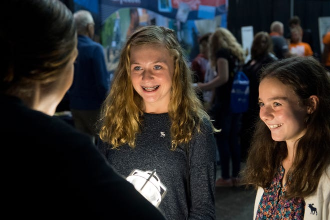Castle North Middle School students, from left, Lydia Bauersfeld, 13, and Ciera Mardes, 13, learn about electricity circuits at the JA JobSpark event at Old National Events Plaza Wednesday morning.