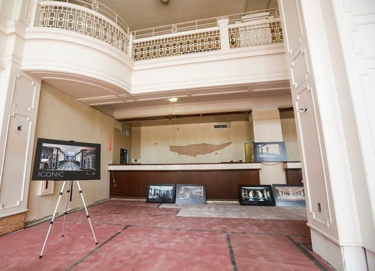 A display photos depicts what the finished interior will look like at the under-construction Hotel Retlaw.