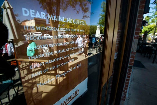 People walk past the former site of the Old Chicago restaurant on South College Avenue on Wednesday, Sept. 26, 2018, in Old Town Fort Collins, Colo.