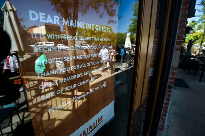 People walk past the former Mainline restaurant at 124 S. College Ave., on Tuesday, Sept. 26, 2018 in Old Town Fort Collins.