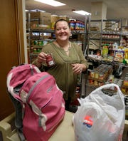 Sheboygan Salvation Army food pantry recipient Rose Hauc, of Sheboygan visits the pantry Sept. 20 in Sheboygan.