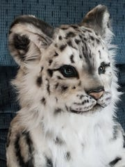 This snow leopard is an example of the soft sculptures created by Judi Paul of Luxemburg.