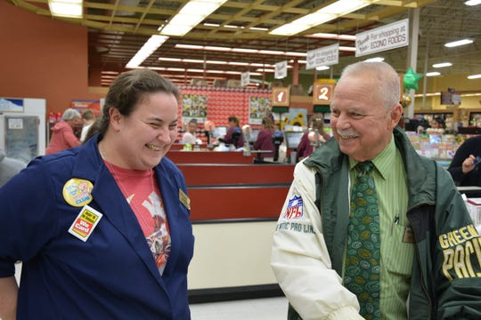 Jim Tadych shares a laugh with Anne Dilley, the front manager at Tadych's Econofoods in Sturgeon Bay.