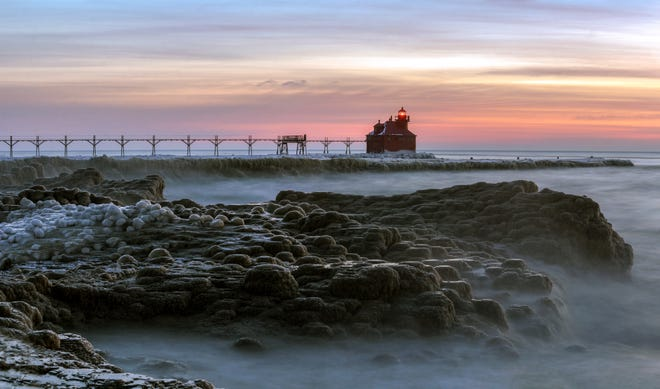 """Michael Marit's winter photo of the Sturgeon Bay Canal Pierhead Lighthouse is included in the 2019 """"Discover Wisconsin"""" calendar."""