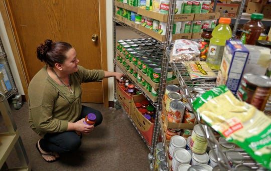 Sheboygan Salvation Army food pantry recipient Rose Hauch selects food Sept. 20 at the pantry.