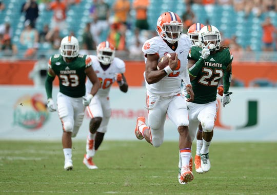 Clemson quarterback Kelly Bryant (2) races 59 yards to score against Miami during the 4th quarter Saturday, Oct. 24, 2015, in Miami Gardens, Fla.