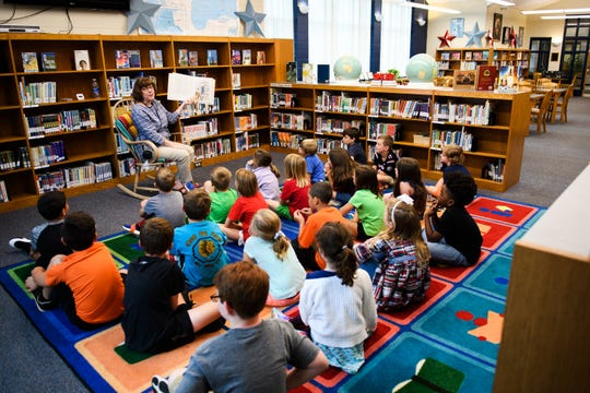 Lisa Aucoin reads to a group of third graders at the Summit Drive Elementary School library on Monday, Sept. 24, 2018.