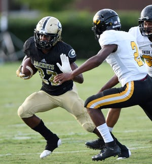 Senior running back Dre Williams (22) and the Greer Yellow Jackets have won four games in a row heading into Friday's Region 2-AAAA opener at Greenville.