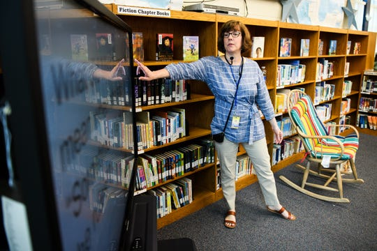 Lisa Aucoin discusses a book she read to a group of third graders at the Summit Drive Elementary School library on Monday, Sept. 24, 2018.