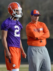 Freshman quarterback Kelly Bryant (2) and coach Dabo Swinney watch practice during the spring drills of 2015.