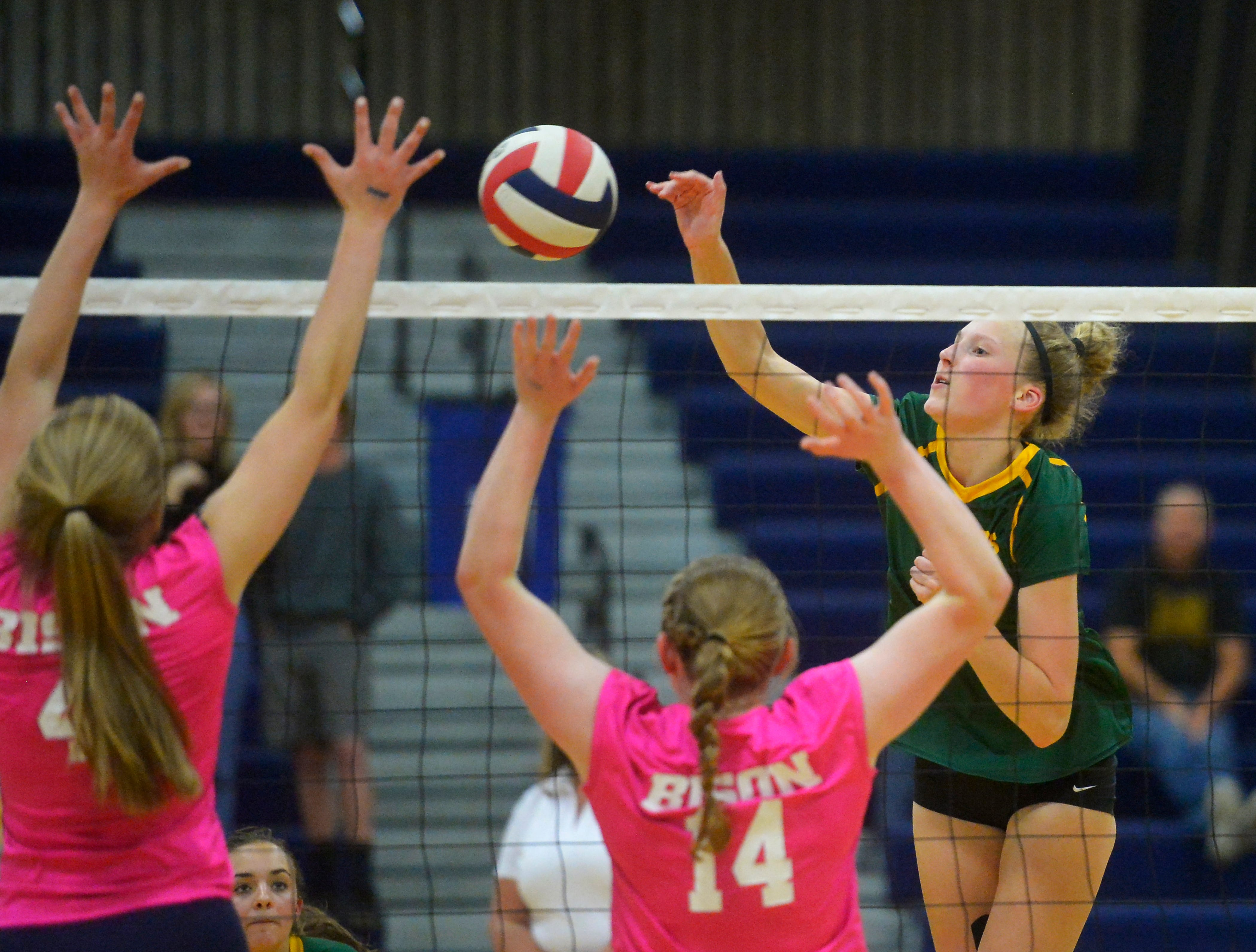 CMR's Allie Olsen spikes during the crosstown volleyball match in the Swarthout Fieldhouse, Tuesday.