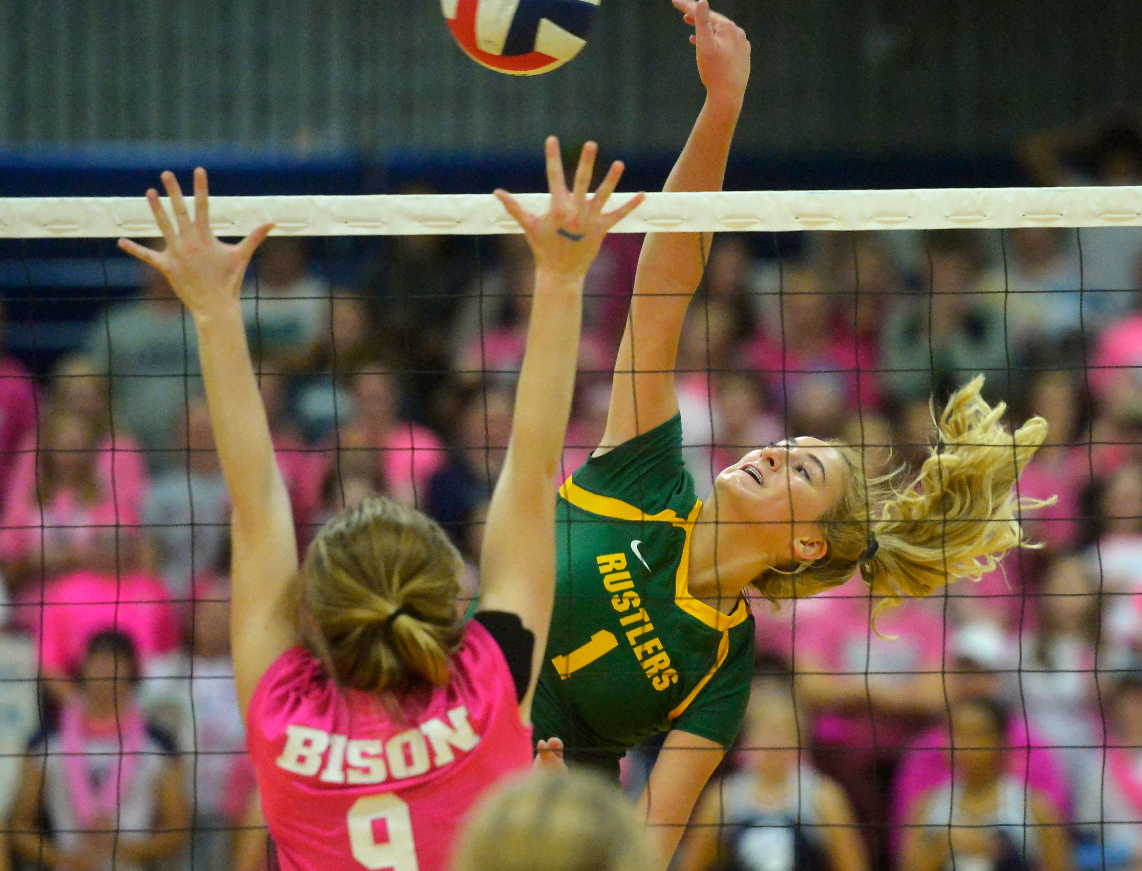 CMR's Maddie Mohler spikes at the net during the crosstown volleyball match in the Swarthout Fieldhouse, Tuesday.
