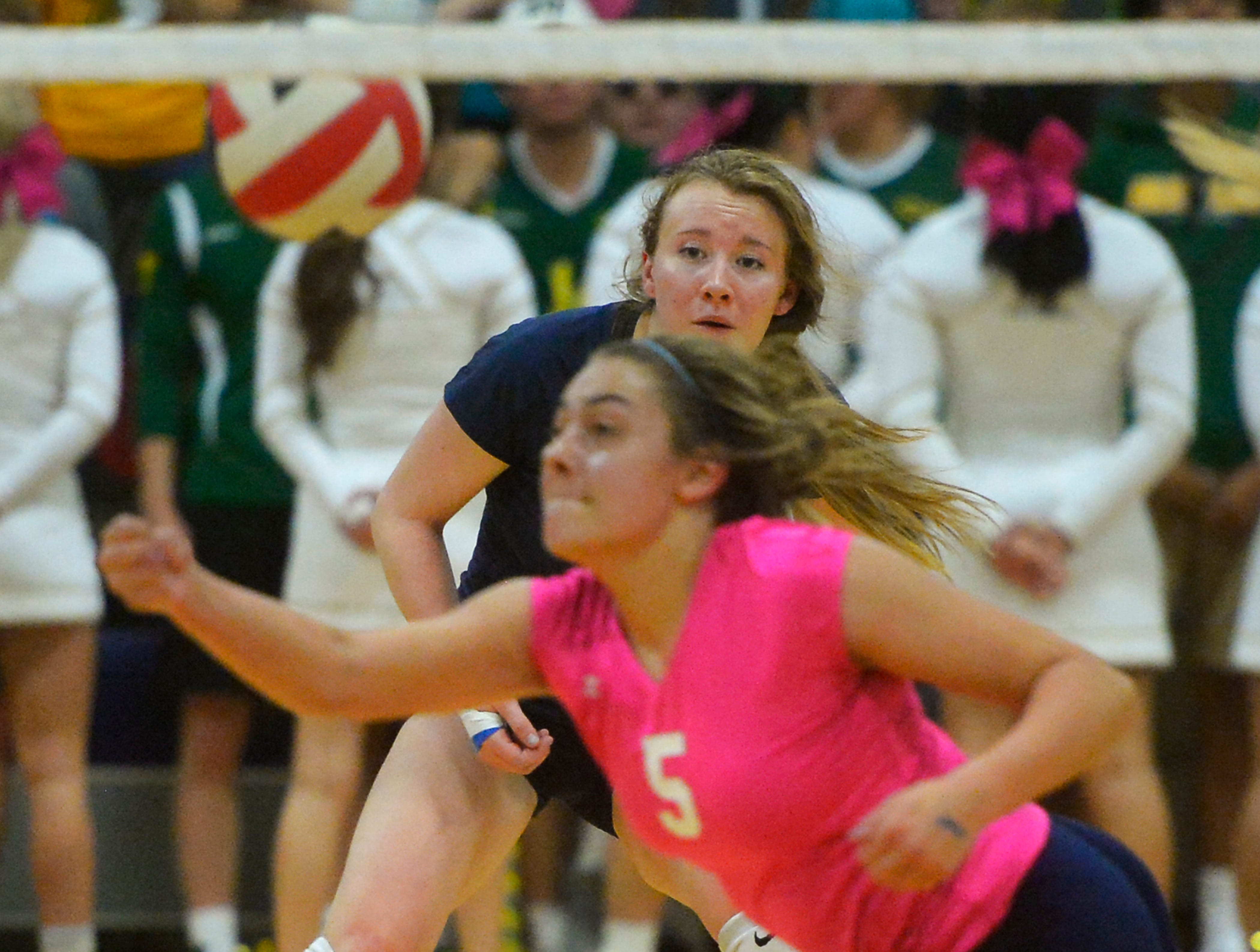 The crosstown volleyball match in the Swarthout Fieldhouse, Tuesday.