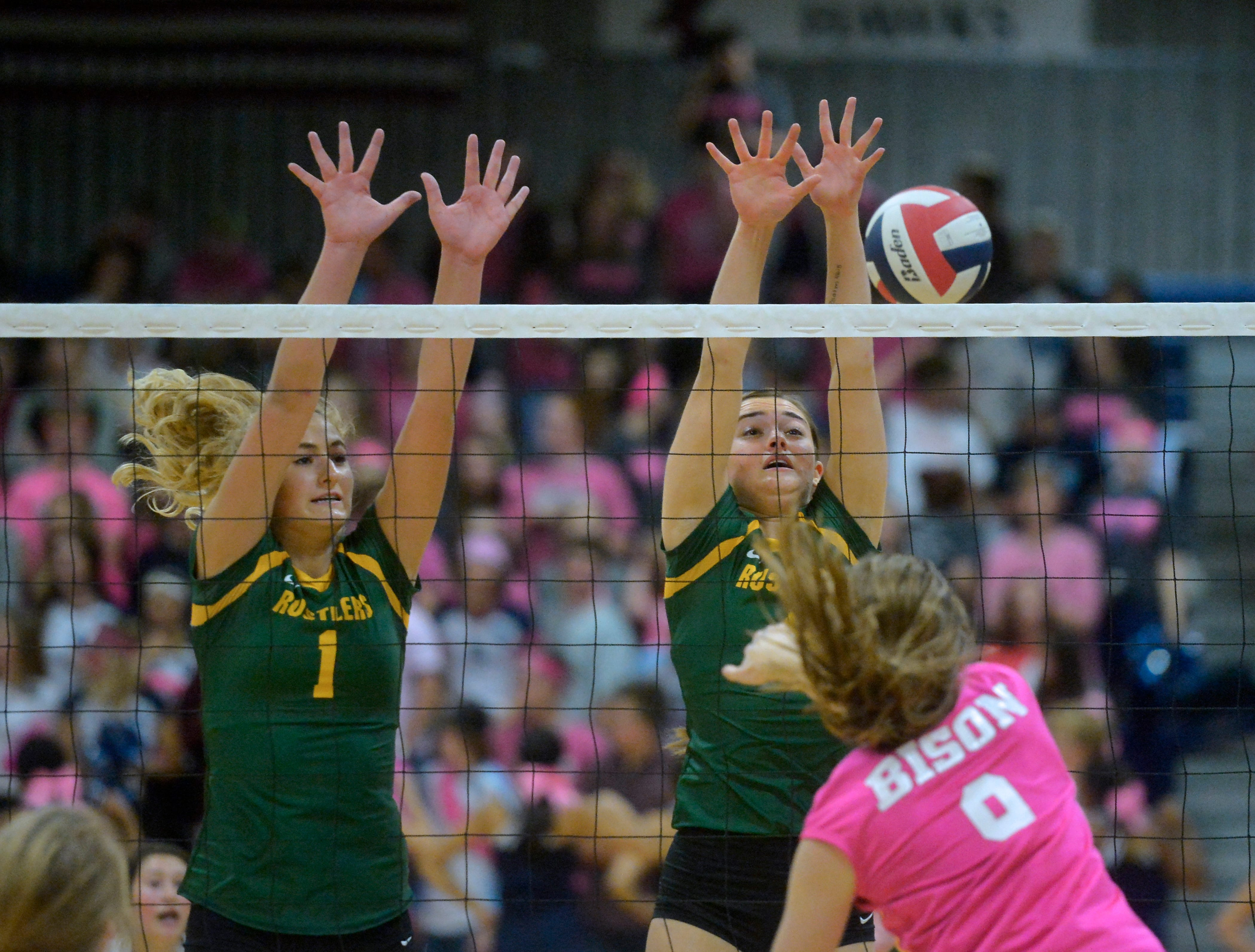 CMR's Maddie Mohler, 1, and Hayden Hilyard defend the net during the crosstown volleyball match in the Swarthout Fieldhouse, Tuesday.