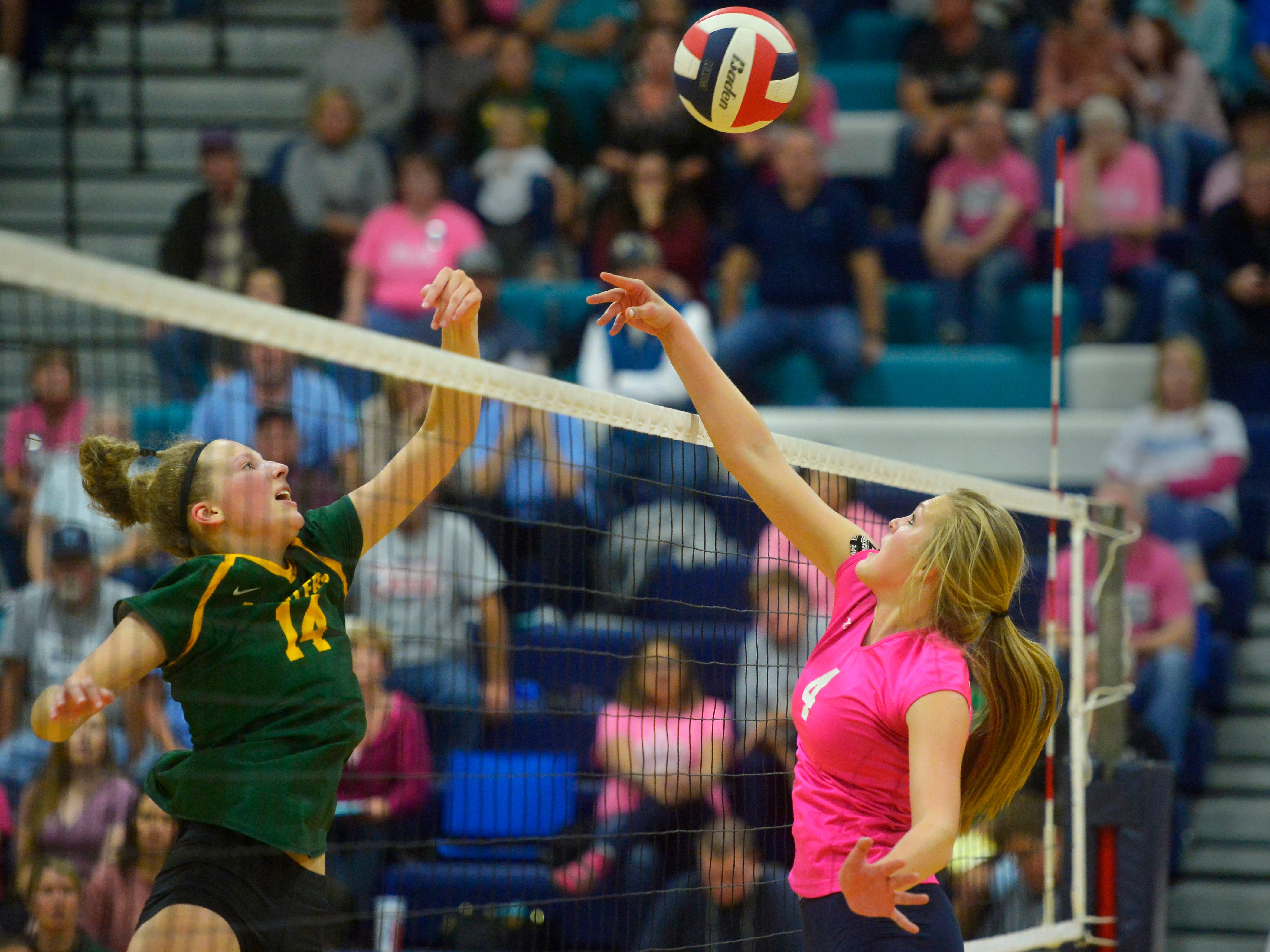 CMR's Allie Olsen and Great Falls High's Abbie Groskreutz battle at the net during the crosstown volleyball match in the Swarthout Fieldhouse, Tuesday.