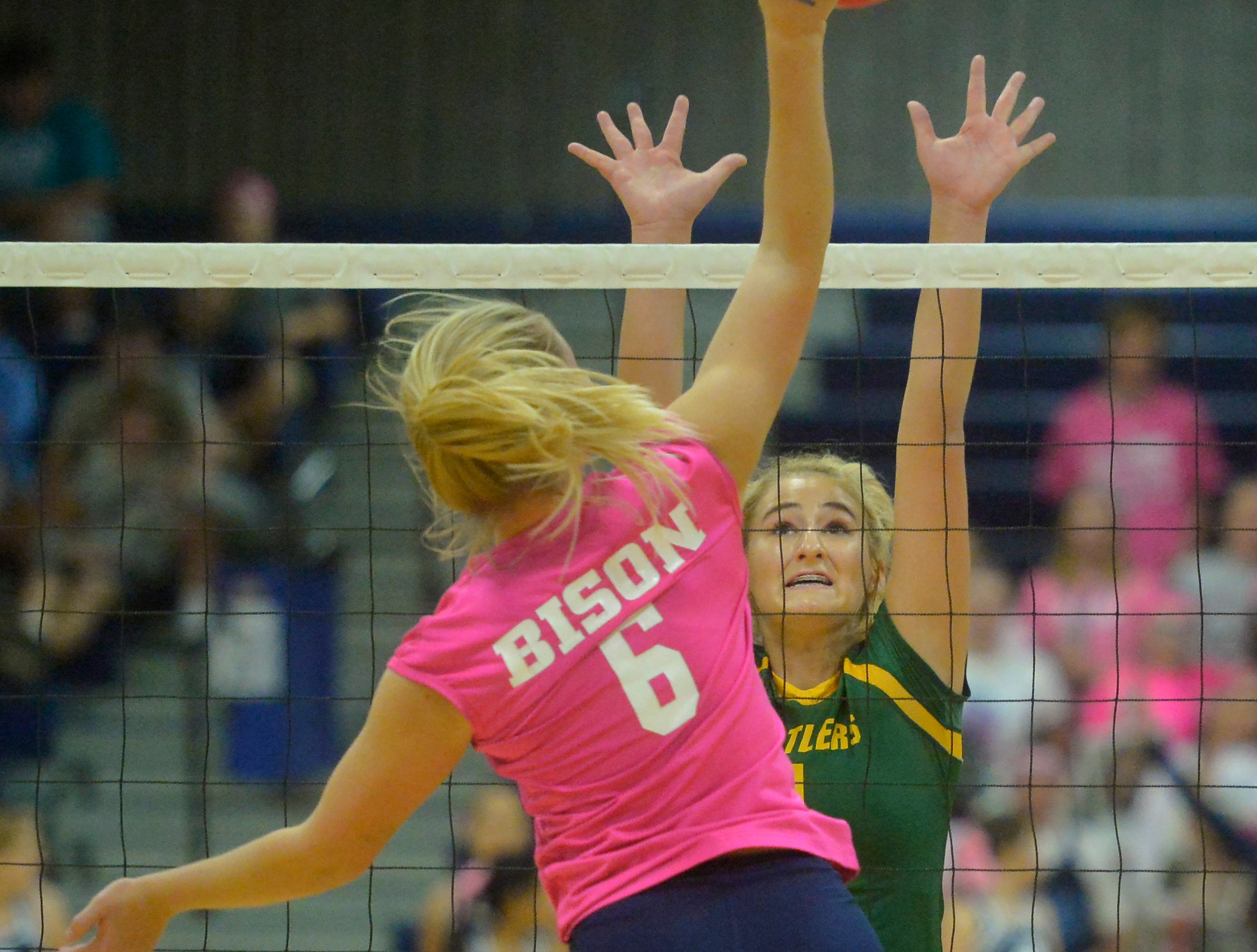 CMR's Maddie Mohler defends the net as Great Falls High's Zoie Lemer attacks with a spike during the crosstown volleyball match in the Swarthout Fieldhouse, Tuesday.