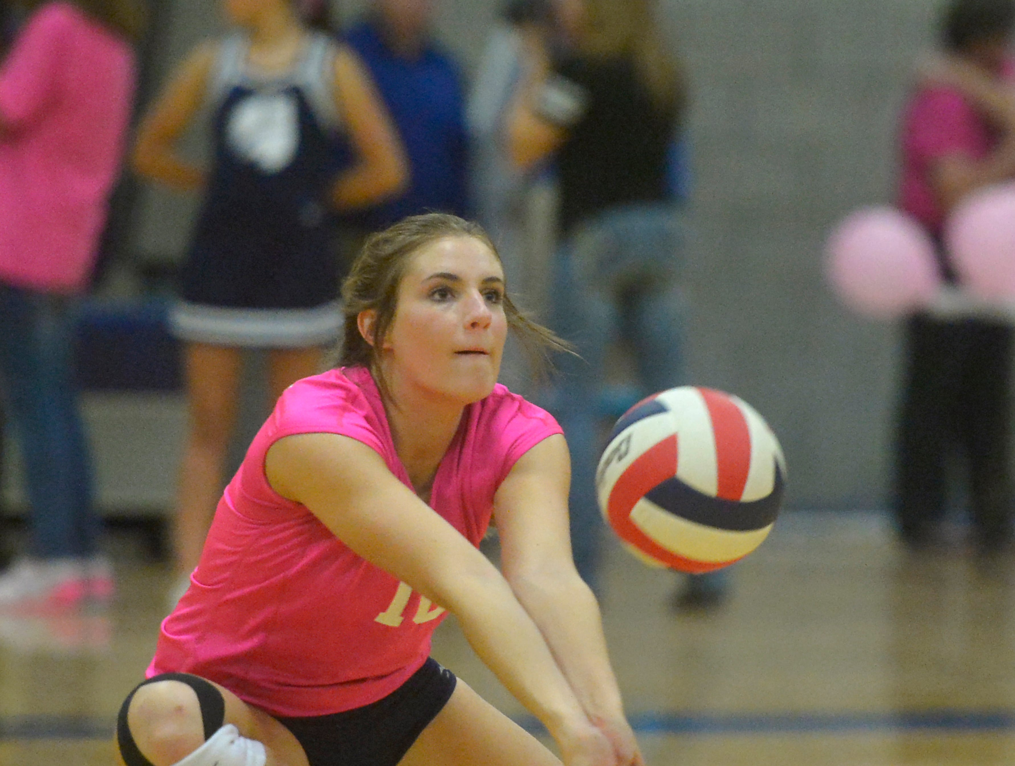 Great Falls High's Hadlee Bleskin makes a dig during the crosstown volleyball match in the Swarthout Fieldhouse, Tuesday.