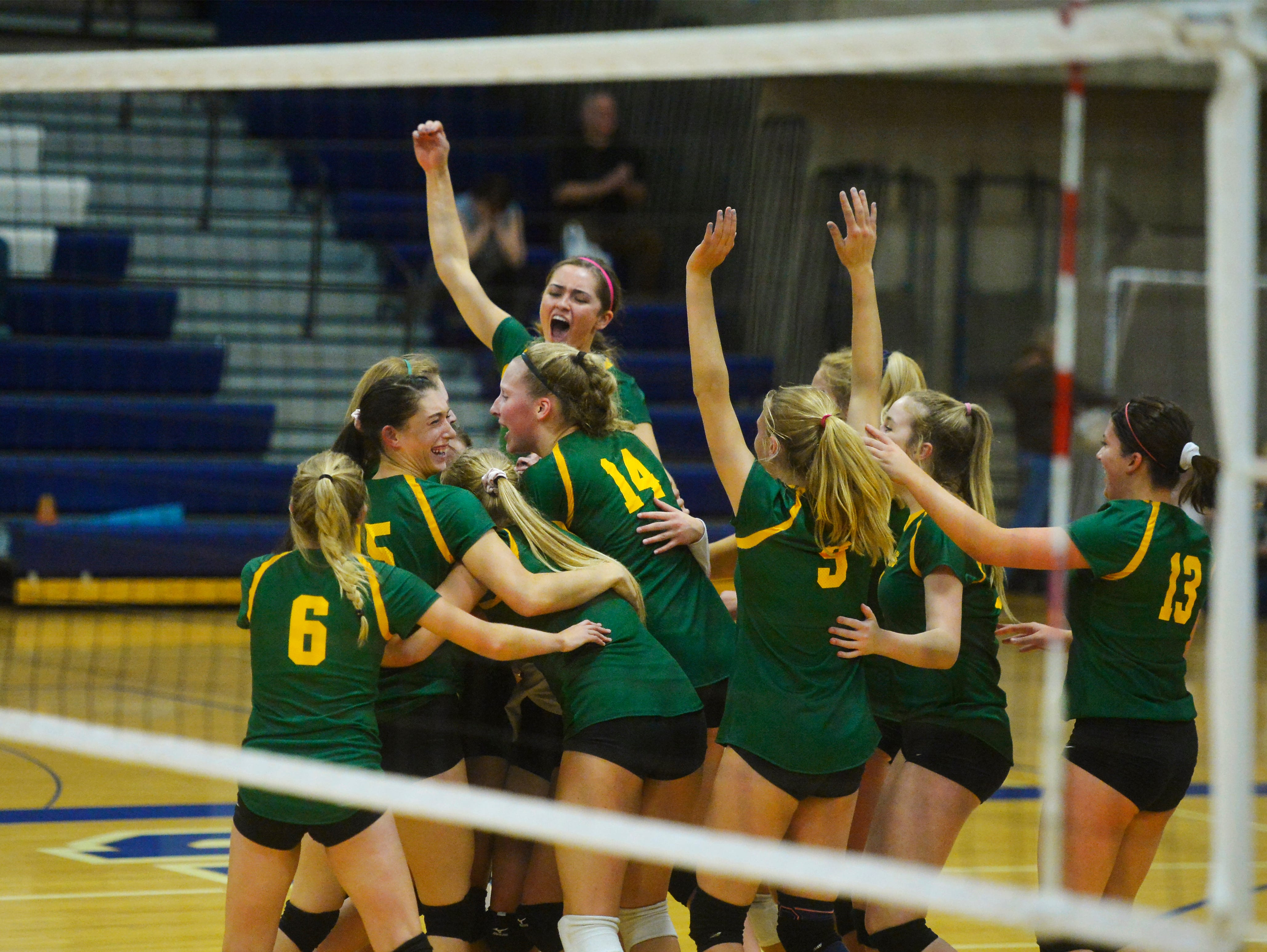 CMR celebrates a victory in the crosstown volleyball match at the Swarthout Fieldhouse, Tuesday.