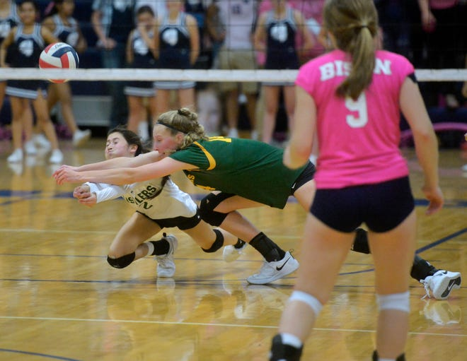 CMR's Lauren Lindseth (No. 2 in white) and Allie Olsen dive for a ball this fall during crosstown volleyball action at Great Falls High's Swarthout Fieldhouse.