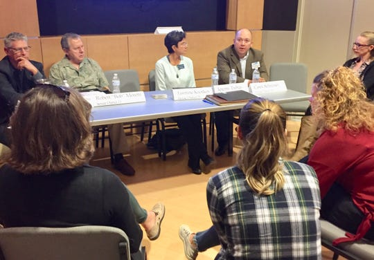 Candidates for state House and Senate seats talk with voters Tuesday at the Great Falls Rising candidates' forum.