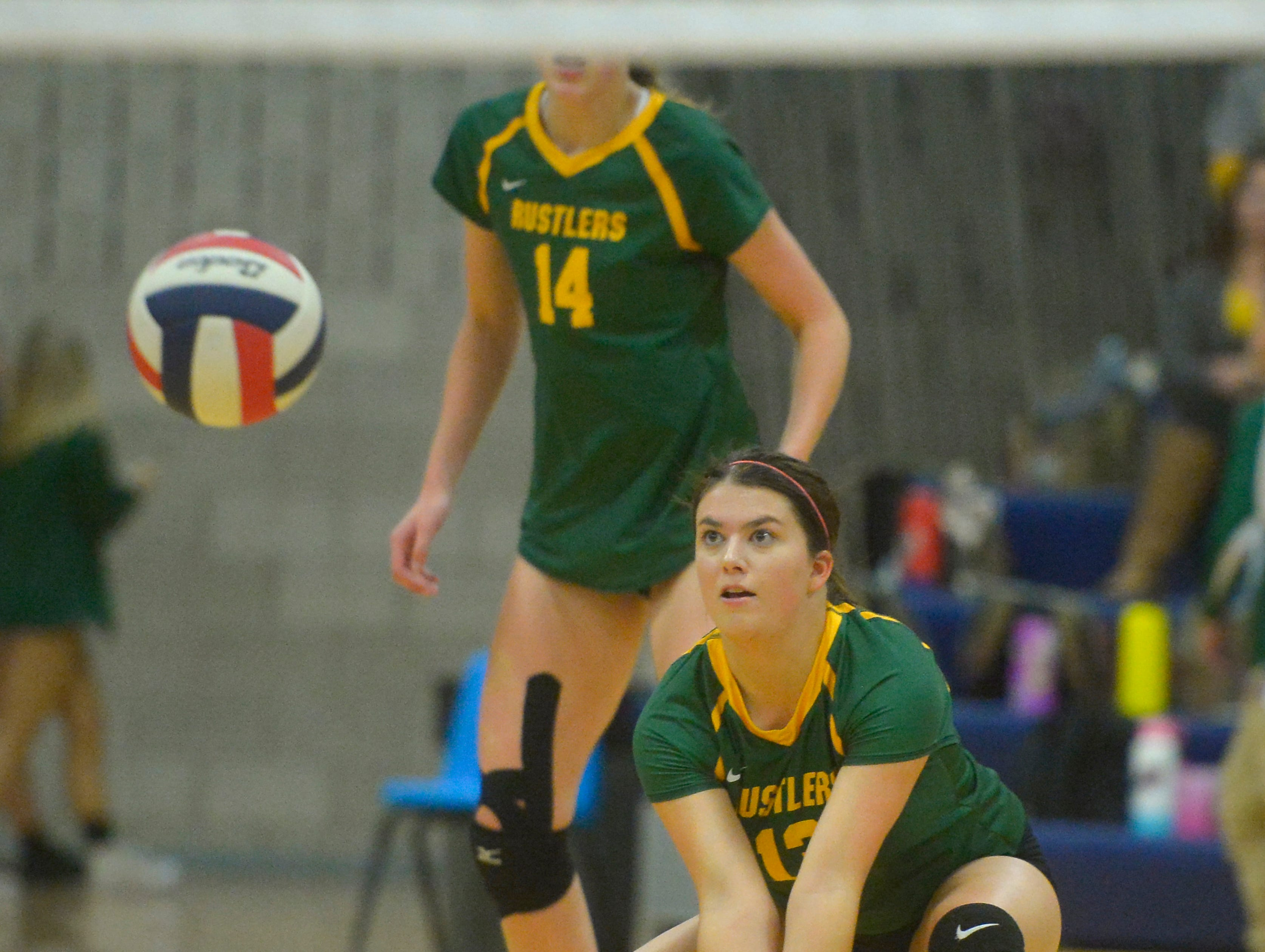 CMR's Ally Dube makes a dig during the crosstown volleyball match in the Swarthout Fieldhouse, Tuesday.