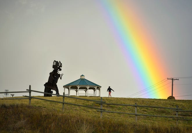 A passing rain storm produces a brilliant rainbow over Great Falls as seen from Overlook Park in 2018. The Great Falls area is expected to see some wet, cooler weather in the coming days.