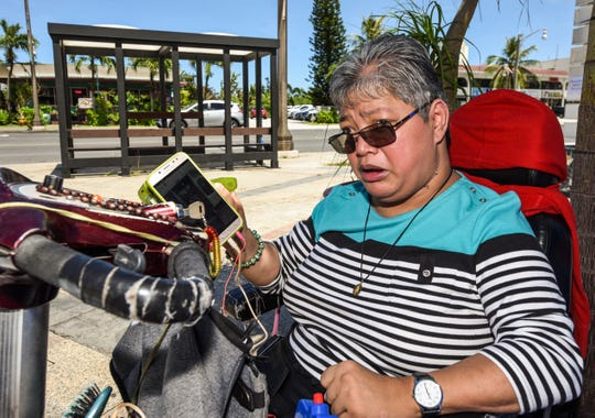 "Frequent and long-time paratransit rider, Evelyn Duenas, expresses her disappointment of a one-week suspension from the public transit system by Guam Regional Transit Authority management during an interview in Tumon on Wednesday, Sept. 26, 2018. Duenas, who was born with cerebral palsy, has been vocal in the past of problems she claims, has plagued the authority and its service. ""The (mass transit) system is more broken than me,"" says Duenas."