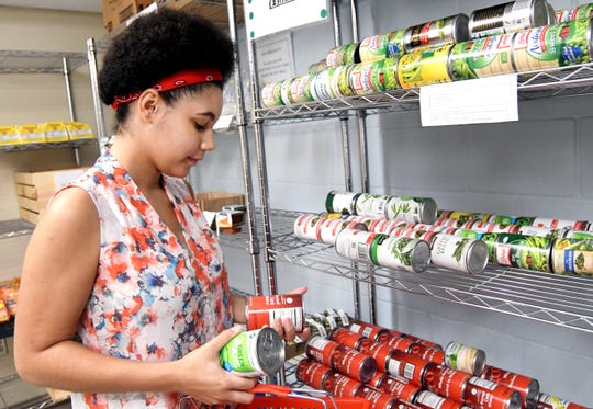 Sophomore Infiniti Polk shows her favorite items to get at Southern Miss' Eagle's Nest Food Pantry on Tuesday, Sept. 25, 2018. The Partnership for a Healthy Mississippi brought representatives of several universities and colleges to the Southern Miss Eagle's Nest food pantry for a discussion of campus hunger.