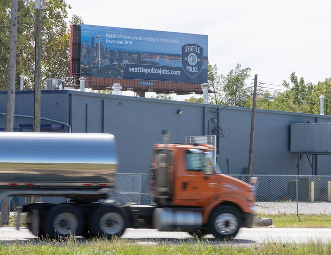 A billboard from Seattle's Police Department that is visible from southbound S. Shadeland Ave, where it crosses English Avenue, Indianapolis, Wednesday, Sept. 26, 2018.