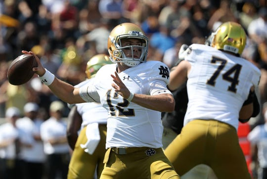 Ian Book #12 of the Notre Dame Fighting Irish drops back to pass against the Wake Forest Demon Deacons during their game at BB&T Field on September 22, 2018 in Winston Salem, North Carolina.