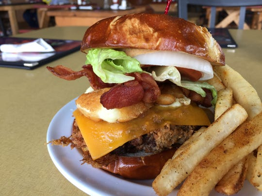 The Brickyard burger at Between the Bun hosts cheddar, fried chees curds and bacon on a fire-grilled and then deep-fried burger. Between the Bun relocated from Greenwood to 2222 Southport Road, at Ind. 37, Indianapolis.