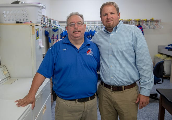 Davey Calvert (left), custodian, and Justin Pelley, head football coach, at Western Boone High School, Thorntown. They and the players realize how important the small things are in life.