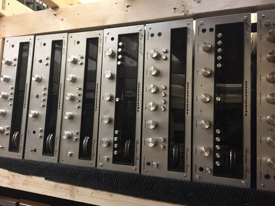 Vintage Marantz tuners and amplifiers line the shelf of a storage rack at Getchell Amplifiers in Brownsburg. The business focuses on the sale and repair of vintage stereo equipment.