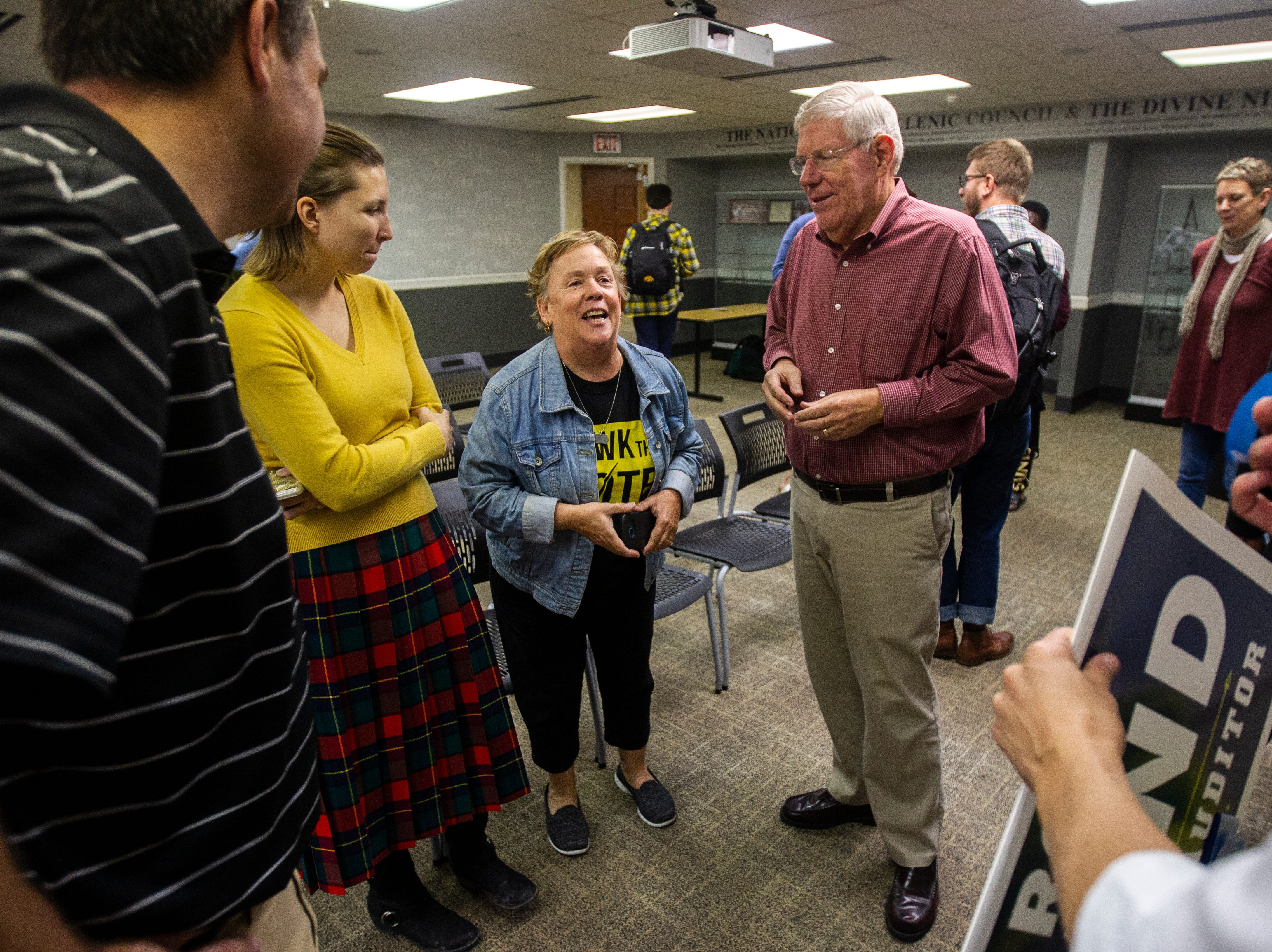 Sue Dvorsky (center) laughs while talking with Tim Gannon, Kalena Meyer, during an event on Wednesday, Sept. 26, 2018, at the Iowa Memorial Union on the University of Iowa campus in Iowa City.