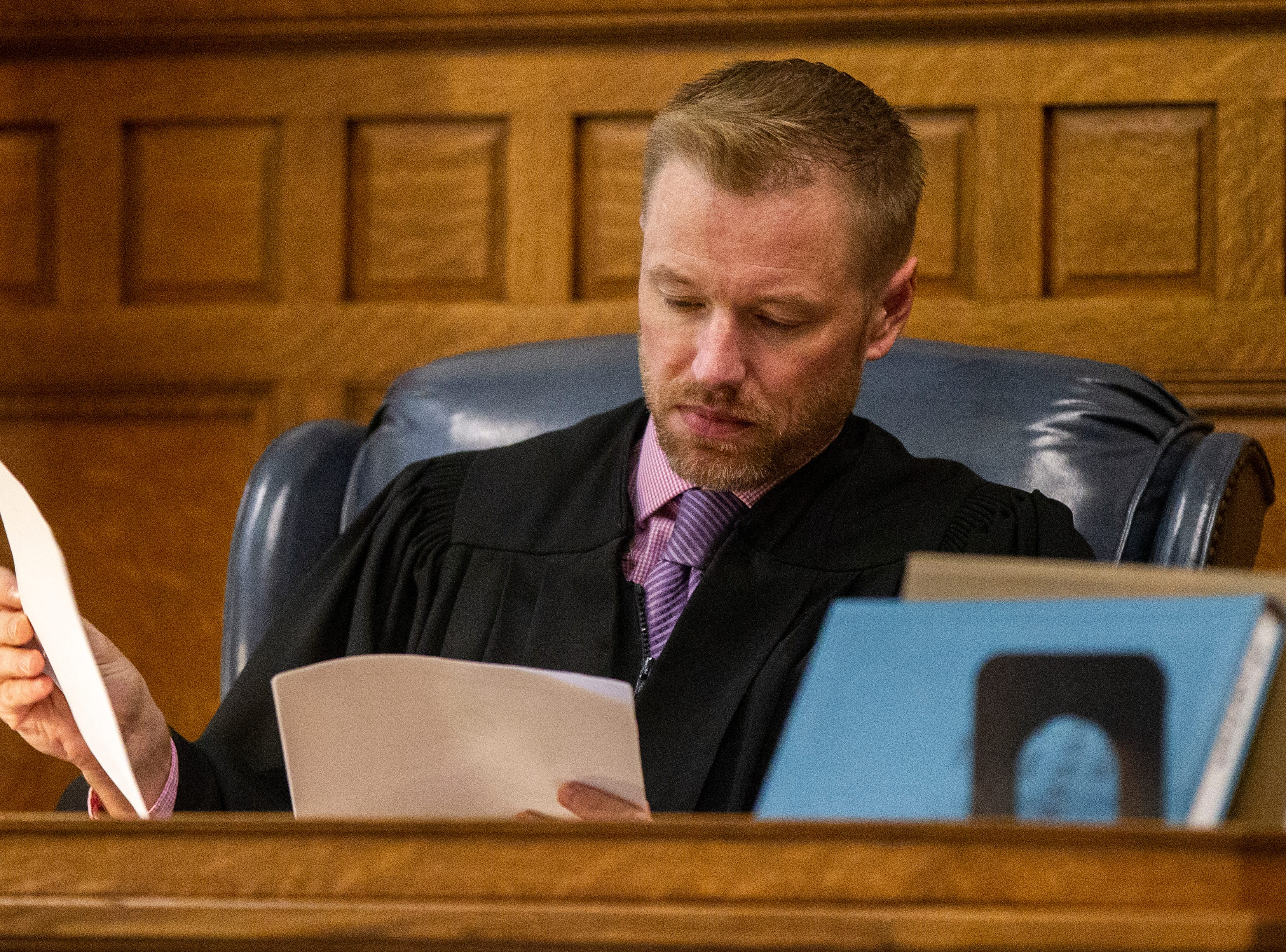 Judge Lars G. Anderson looks through papers during a pre-trial hearing for Curtis Jones on Wednesday, Sept. 26, 2018, at the Johnson County Courthouse in Iowa City.