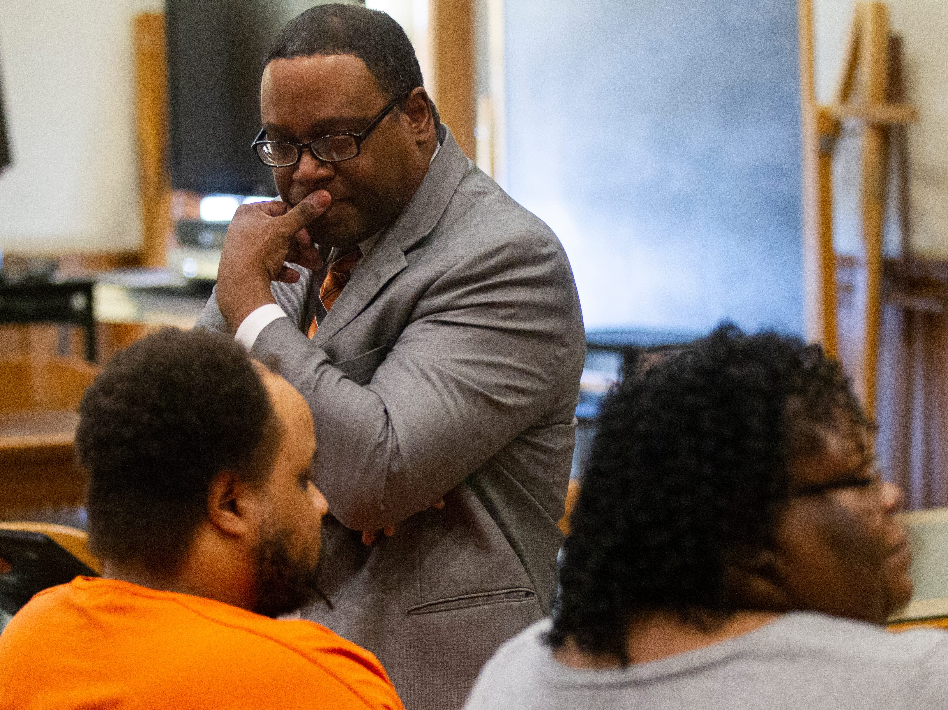 Doug Davis listens to Curtis Jones during a pre-trial hearing on Wednesday, Sept. 26, 2018, at the Johnson County Courthouse in Iowa City.