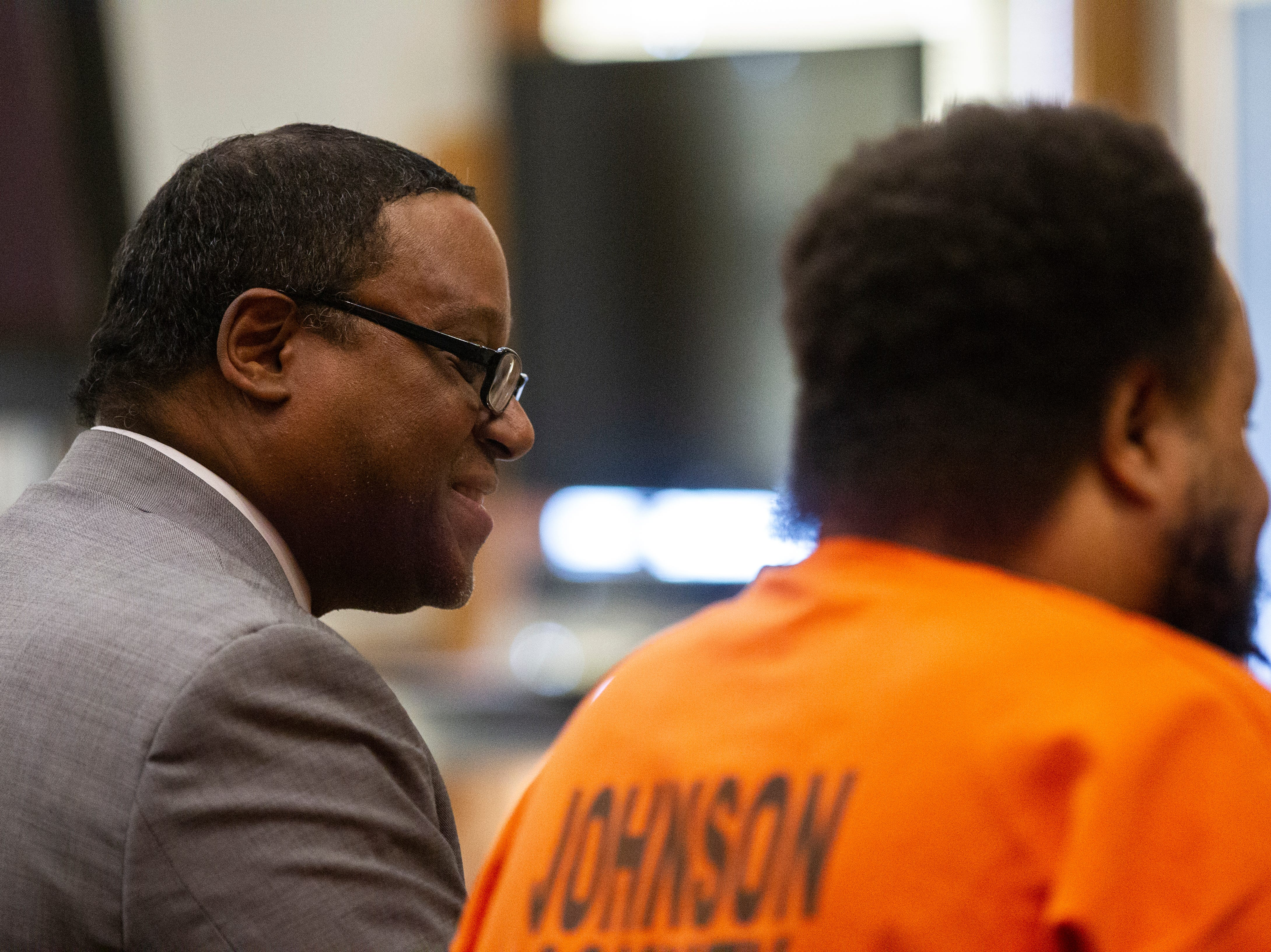 Doug Davis talks with Curtis Jones during a pre-trial hearing on Wednesday, Sept. 26, 2018, at the Johnson County Courthouse in Iowa City.