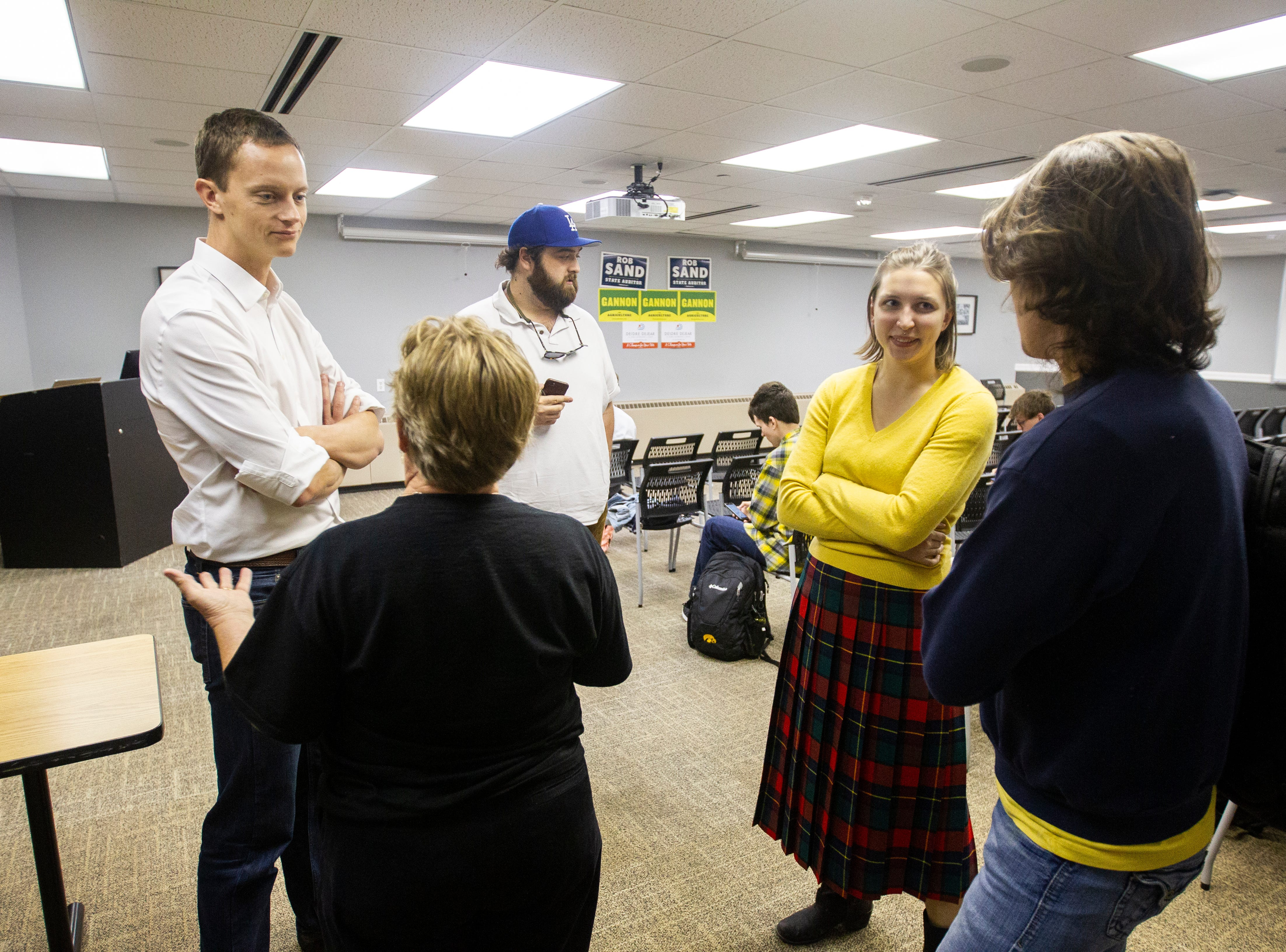Rob Sand, Democratic candidate for Iowa state auditor, (from left) talks with Sue Dvorsky while UI students Kalena Meyer and Ryan Hall talk before an event on Wednesday, Sept. 26, 2018, at the Iowa Memorial Union on the University of Iowa campus in Iowa City.