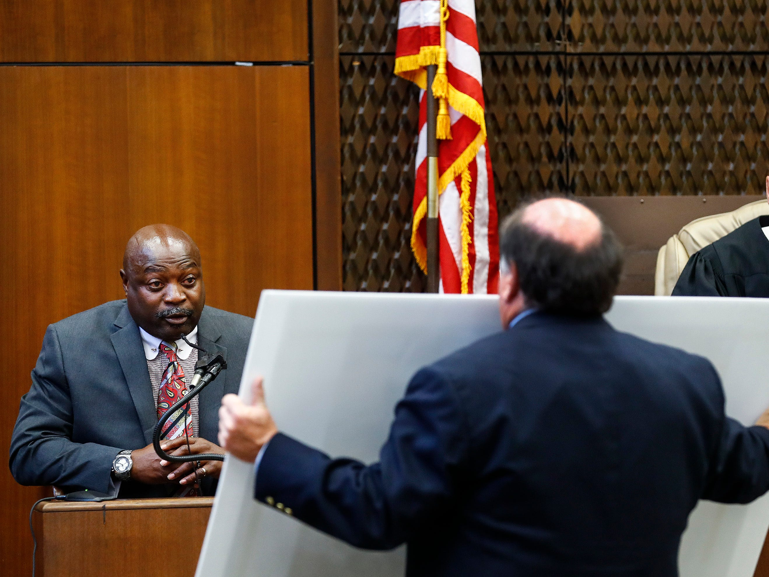 Judge Gerald Chatman, right, listens as lead prosecutor John Champion, center, questions witness Lt. Edward Dickson on the second day of the retrial of Quinton Tellis in Batesville, Mississippi on Wednesday, Sept. 26, 2018. Tellis is charged with burning 19-year-old Jessica Chambers to death almost three years ago on Dec. 6, 2014. He has pleaded not guilty to the murder. (Mark Weber/The Commercial Appeal via AP, Pool)