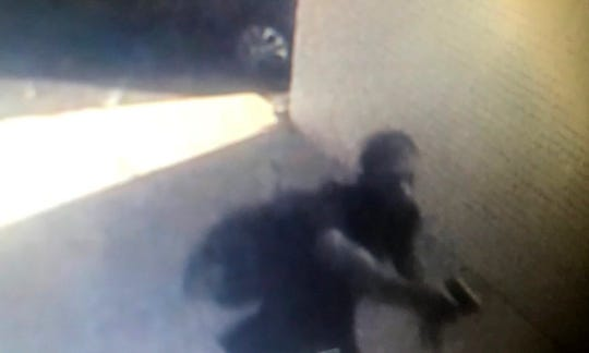 This surveillance image shows a suspect in a robbery of a woman in the Belhaven neighborhood.