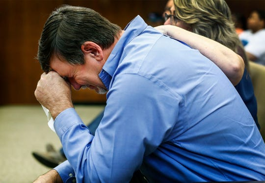 Ben Chambers, father of Jessica Chambers, breaks down during testimony in the retrial of Quinton Tellis in Batesville, Miss., on Wednesday, Sept. 26, 2018. Tellis is charged with burning 19-year-old Chambers to death in December 2014. Tellis has pleaded not guilty to the murder. (Mark Weber /The Commercial Appeal via AP, Pool)