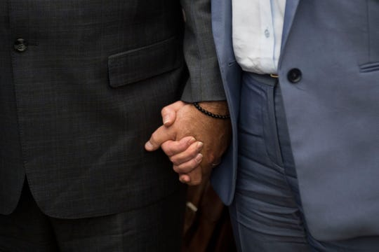 Former Pilot Flying J President Mark Hazelwood holds hands with his wife Joanne as he exits the federal courthouse in Chattanooga on Wednesday, Sept. 26, 2018.  Hazelwood was sentenced to 150 months in prison and fined $750,000 by Senior U.S. District Judge Curtis Collier today.