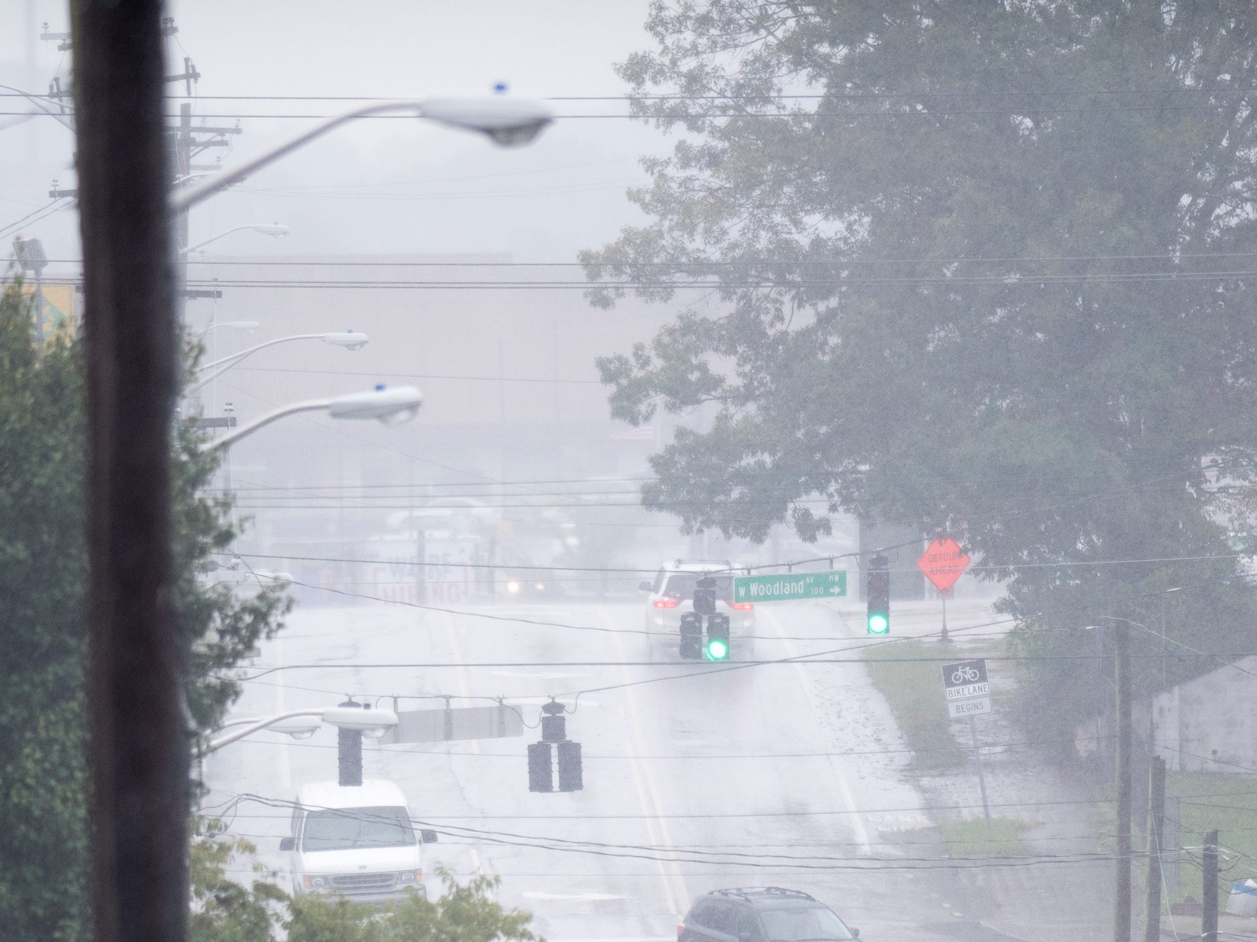 Heavy rains obscures Central Avenue during an afternoon rain shower in Knoxville, Tennessee on Wednesday, September 26, 2018. A flood watch for the area was issued around 1pm until 7pm.